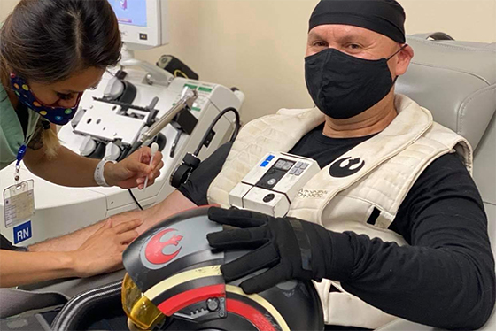 A Resistance Pilot from Star Wars cosplayer prepares to donate blood.